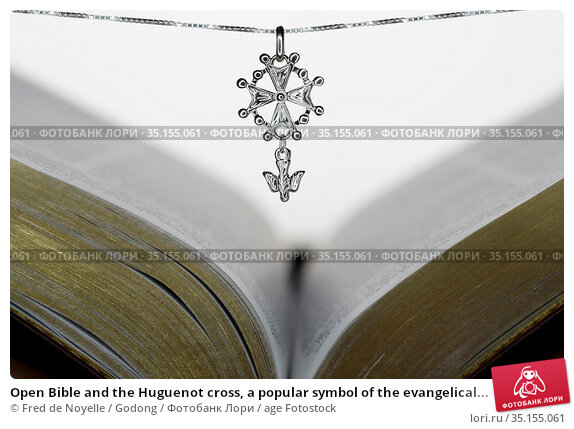 Open Bible and the Huguenot cross, a popular symbol of the evangelical... Стоковое фото, фотограф Fred de Noyelle / Godong / age Fotostock / Фотобанк Лори