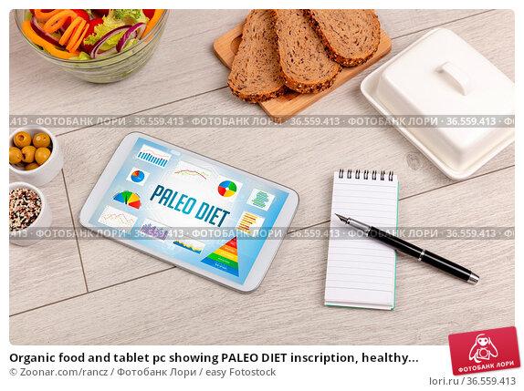 Organic food and tablet pc showing PALEO DIET inscription, healthy... Стоковое фото, фотограф Zoonar.com/rancz / easy Fotostock / Фотобанк Лори
