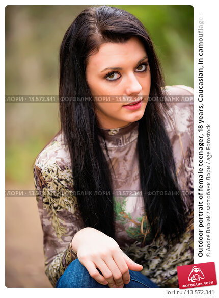 Купить «Outdoor portrait of female teenager, 18 years, Caucasian, in camouflage sweater and denim jeans», фото № 13572341, снято 7 декабря 2019 г. (c) age Fotostock / Фотобанк Лори