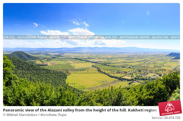 Купить «Panoramic view of the Alazani valley from the height of the hill. Kakheti region», фото № 26674725, снято 21 марта 2019 г. (c) Mikhail Starodubov / Фотобанк Лори