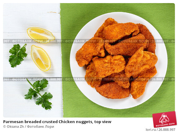 Купить «Parmesan breaded crusted Chicken nuggets, top view», фото № 26888997, снято 13 мая 2017 г. (c) Oksana Zh / Фотобанк Лори