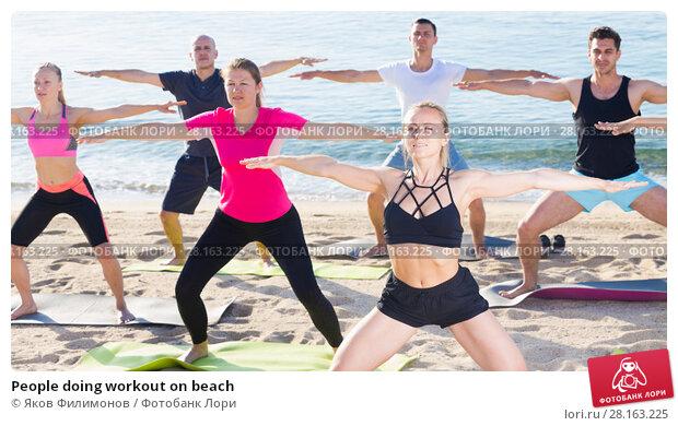 Купить «People doing workout on beach», фото № 28163225, снято 14 июня 2017 г. (c) Яков Филимонов / Фотобанк Лори