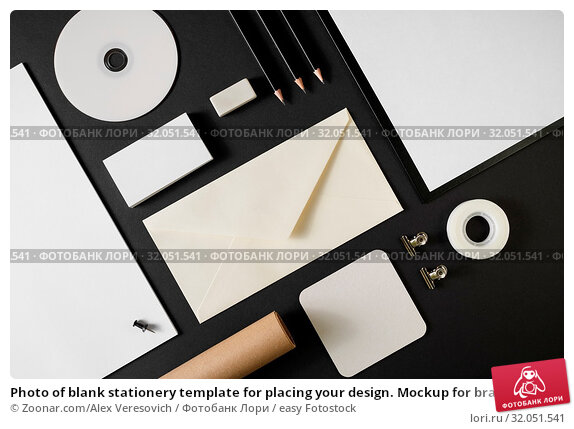Photo of blank stationery template for placing your design. Mockup for branding identity on black paper background. Top view. Стоковое фото, фотограф Zoonar.com/Alex Veresovich / easy Fotostock / Фотобанк Лори