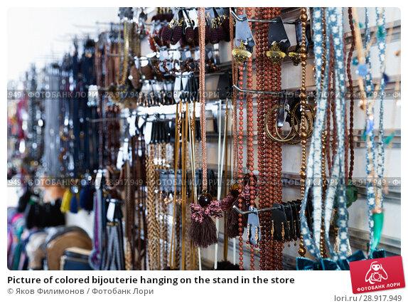 Купить «Picture of colored bijouterie hanging on the stand in the store», фото № 28917949, снято 17 января 2018 г. (c) Яков Филимонов / Фотобанк Лори