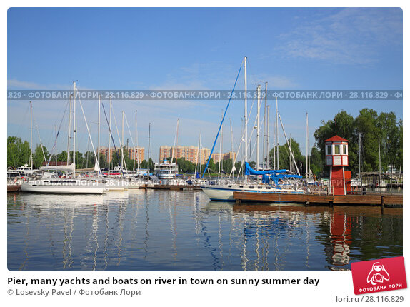 Купить «Pier, many yachts and boats on river in town on sunny summer day», фото № 28116829, снято 19 августа 2016 г. (c) Losevsky Pavel / Фотобанк Лори