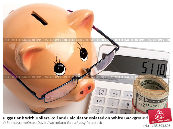 Piggy Bank With Dollars Roll and Calculator Isolated on White Background... Стоковое фото, фотограф Zoonar.com/Orcea David / easy Fotostock / Фотобанк Лори