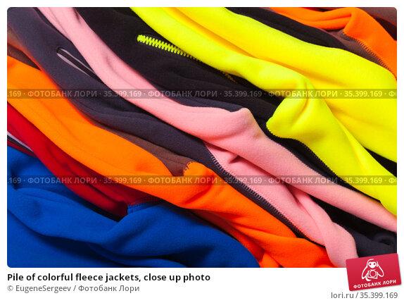 Pile of colorful fleece jackets, close up photo. Стоковое фото, фотограф EugeneSergeev / Фотобанк Лори