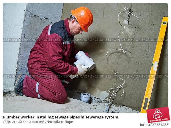 Купить «Plumber worker installing sewage pipes in sewerage system», фото № 27381353, снято 28 сентября 2017 г. (c) Дмитрий Калиновский / Фотобанк Лори