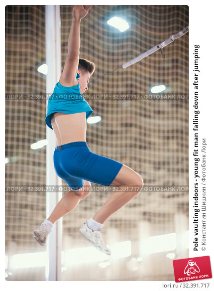 Купить «Pole vaulting indoors - young fit man falling down after jumping», фото № 32391717, снято 1 ноября 2019 г. (c) Константин Шишкин / Фотобанк Лори