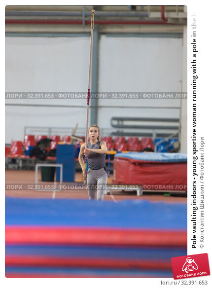Купить «Pole vaulting indoors - young sportive woman running with a pole in the hands - looking up at the pole before jumping», фото № 32391653, снято 1 ноября 2019 г. (c) Константин Шишкин / Фотобанк Лори