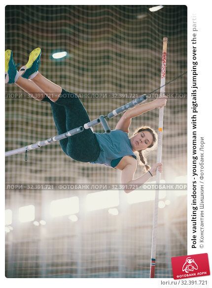 Купить «Pole vaulting indoors - young woman with pigtails jumping over the partition - bright lighting on the background», фото № 32391721, снято 1 ноября 2019 г. (c) Константин Шишкин / Фотобанк Лори