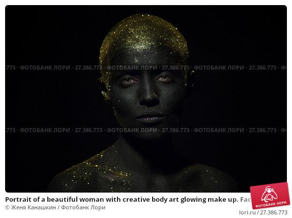 Купить «Portrait of a beautiful woman with creative body art glowing make up. Face is colored with black paint.», фото № 27386773, снято 7 января 2018 г. (c) Женя Канашкин / Фотобанк Лори