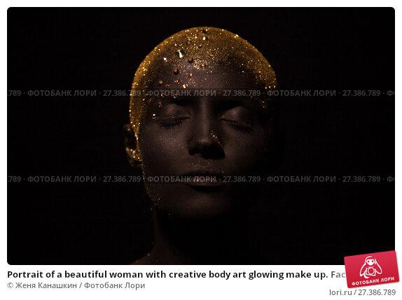 Купить «Portrait of a beautiful woman with creative body art glowing make up. Face is colored with black paint.», фото № 27386789, снято 7 января 2018 г. (c) Женя Канашкин / Фотобанк Лори