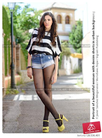Купить «Portrait of a beautiful woman with denim shorts in urban backgroung», фото № 28536401, снято 18 мая 2013 г. (c) Ingram Publishing / Фотобанк Лори