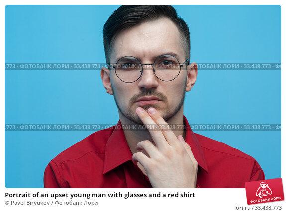 Купить «Portrait of an upset young man with glasses and a red shirt», фото № 33438773, снято 14 апреля 2019 г. (c) Pavel Biryukov / Фотобанк Лори