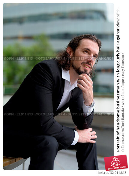 Portrait of handsome businessman with long curly hair against view of the city in Bangkok, Thailand. Стоковое фото, фотограф Zoonar.com/Toni Rantala / easy Fotostock / Фотобанк Лори