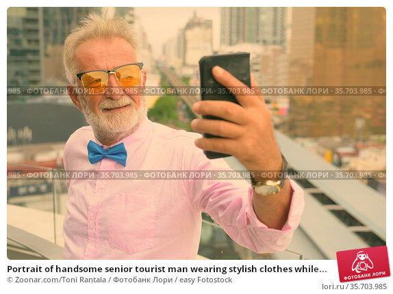 Portrait of handsome senior tourist man wearing stylish clothes while... Стоковое фото, фотограф Zoonar.com/Toni Rantala / easy Fotostock / Фотобанк Лори