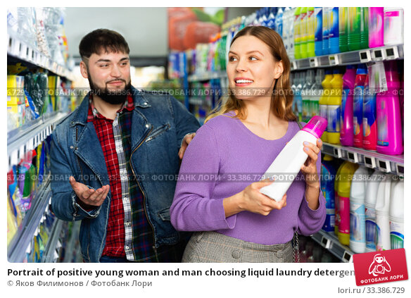 Купить «Portrait of positive young woman and man choosing liquid laundry detergents during shopping at supermarket», фото № 33386729, снято 24 мая 2020 г. (c) Яков Филимонов / Фотобанк Лори