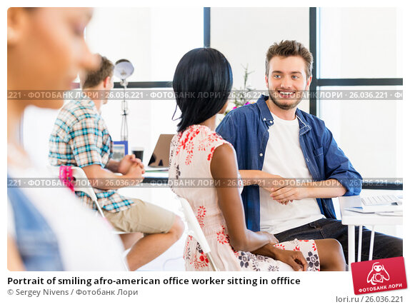 Купить «Portrait of smiling afro-american office worker sitting in offfice», фото № 26036221, снято 13 декабря 2014 г. (c) Sergey Nivens / Фотобанк Лори