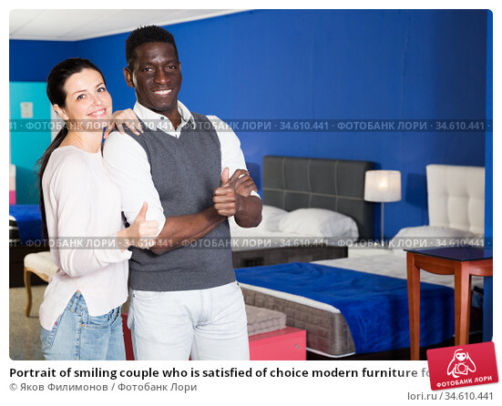 Portrait of smiling couple who is satisfied of choice modern furniture for their home. Стоковое фото, фотограф Яков Филимонов / Фотобанк Лори