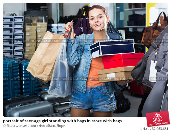 portrait of teenage girl standing with bags in store with bags. Стоковое фото, фотограф Яков Филимонов / Фотобанк Лори