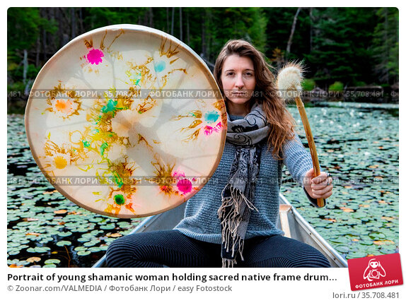 Portrait of young shamanic woman holding sacred native frame drum... Стоковое фото, фотограф Zoonar.com/VALMEDIA / easy Fotostock / Фотобанк Лори