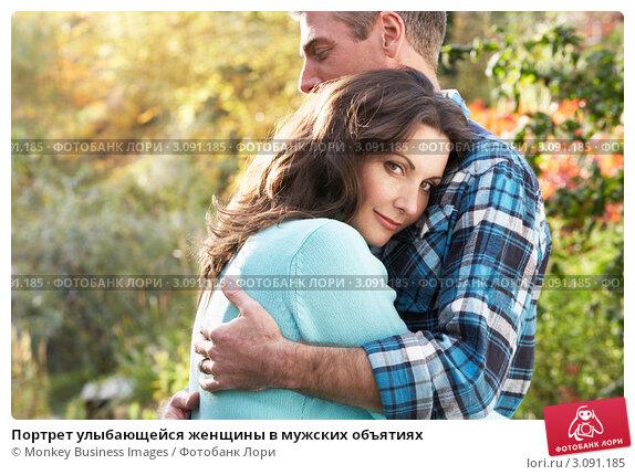Купить «Портрет улыбающейся женщины в мужских объятиях», фото № 3091185, снято 18 октября 2009 г. (c) Monkey Business Images / Фотобанк Лори