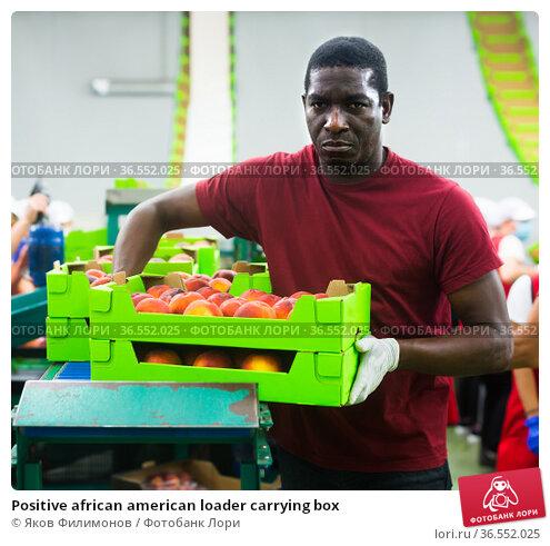 Positive african american loader carrying box. Стоковое фото, фотограф Яков Филимонов / Фотобанк Лори