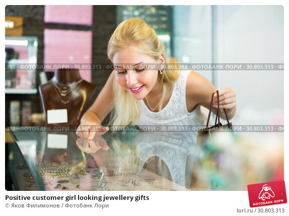 Купить «Positive customer girl looking jewellery gifts», фото № 30803313, снято 17 июня 2019 г. (c) Яков Филимонов / Фотобанк Лори