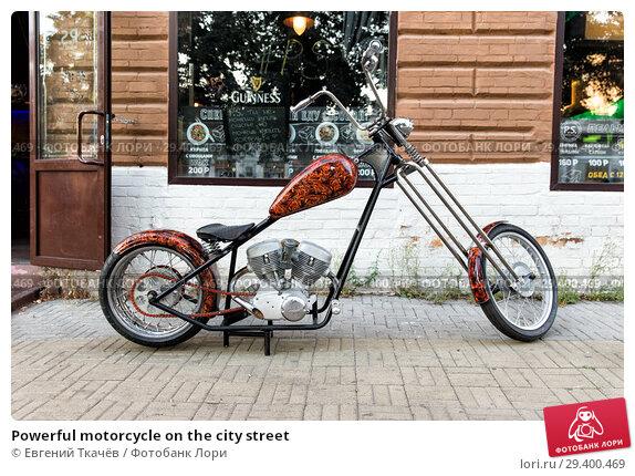 Купить «Powerful motorcycle on the city street», фото № 29400469, снято 6 августа 2016 г. (c) Евгений Ткачёв / Фотобанк Лори