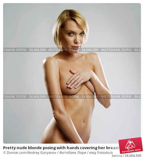 Pretty nude blonde posing with hands covering her breasts. Стоковое фото, фотограф Zoonar.com/Andrey Guryanov / easy Fotostock / Фотобанк Лори