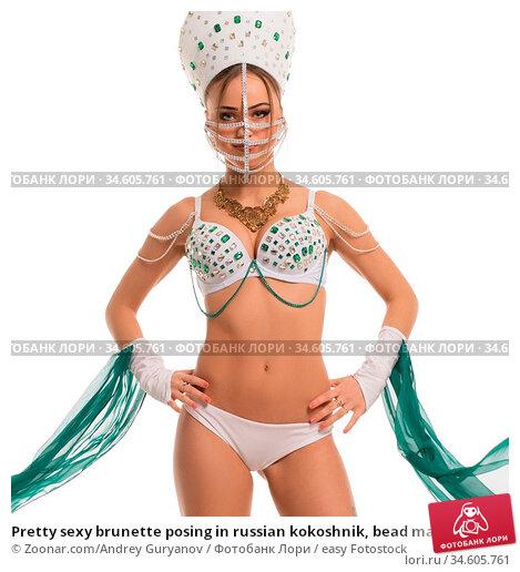 Pretty sexy brunette posing in russian kokoshnik, bead mask on her... Стоковое фото, фотограф Zoonar.com/Andrey Guryanov / easy Fotostock / Фотобанк Лори