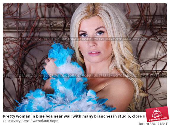 Купить «Pretty woman in blue boa near wall with many branches in studio, close up», фото № 28171341, снято 27 ноября 2015 г. (c) Losevsky Pavel / Фотобанк Лори