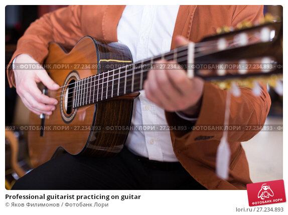 Купить «Professional guitarist practicing on guitar», фото № 27234893, снято 29 марта 2017 г. (c) Яков Филимонов / Фотобанк Лори