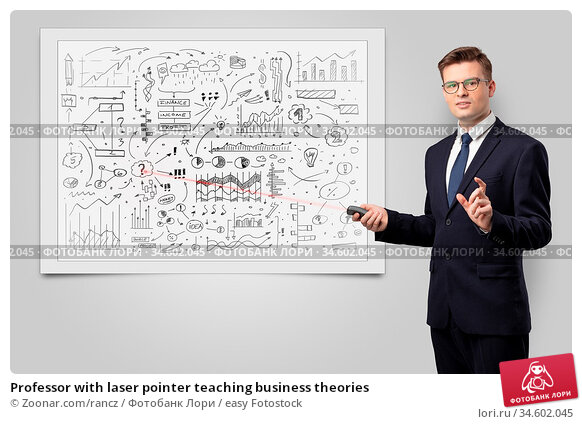 Professor with laser pointer teaching business theories. Стоковое фото, фотограф Zoonar.com/rancz / easy Fotostock / Фотобанк Лори