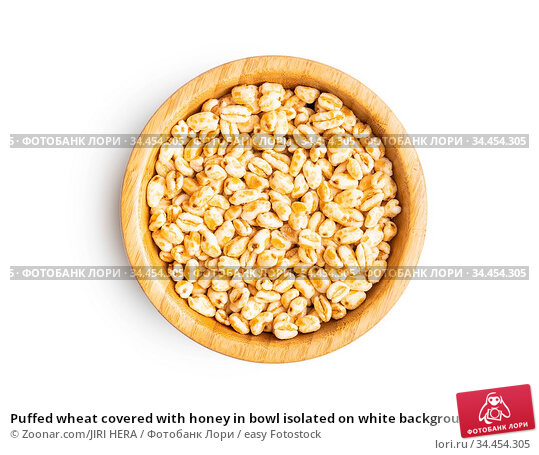Puffed wheat covered with honey in bowl isolated on white background. Стоковое фото, фотограф Zoonar.com/JIRI HERA / easy Fotostock / Фотобанк Лори