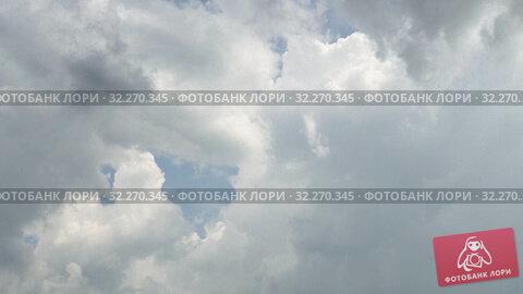 Купить «Rain is visible between thunderclouds. Storm clouds and light in sky. 4K video», видеоролик № 32270345, снято 16 октября 2019 г. (c) Dmitry Domashenko / Фотобанк Лори