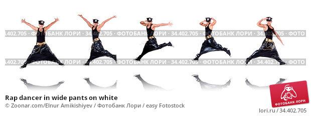 Rap dancer in wide pants on white. Стоковое фото, фотограф Zoonar.com/Elnur Amikishiyev / easy Fotostock / Фотобанк Лори