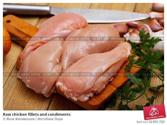 Raw chicken fillets and condiments. Стоковое фото, фотограф Яков Филимонов / Фотобанк Лори