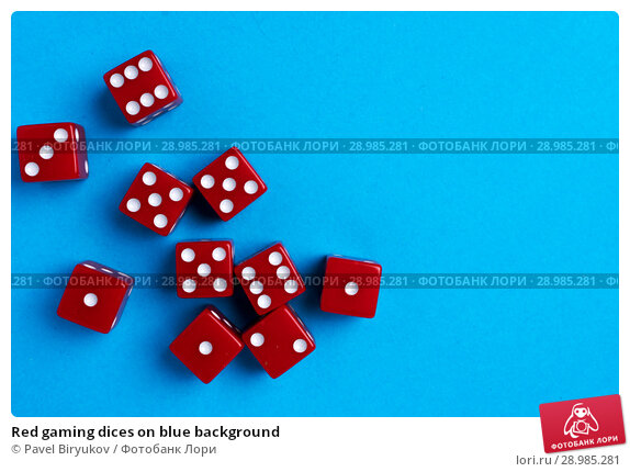 Купить «Red gaming dices on blue background», фото № 28985281, снято 3 января 2018 г. (c) Pavel Biryukov / Фотобанк Лори
