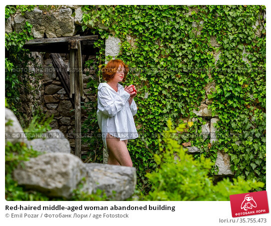 Red-haired middle-aged woman abandoned building. Стоковое фото, фотограф Emil Pozar / age Fotostock / Фотобанк Лори