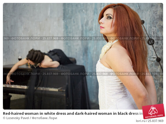 Купить «Red-haired woman in white dress and dark-haired woman in black dress in room with old grand piano, focus on red-haired», фото № 25837969, снято 12 февраля 2015 г. (c) Losevsky Pavel / Фотобанк Лори