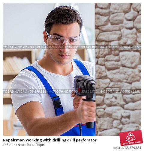 Купить «Repairman working with drilling drill perforator», фото № 33579881, снято 9 декабря 2016 г. (c) Elnur / Фотобанк Лори