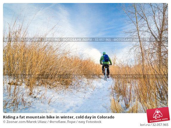 Riding a fat mountain bike in winter, cold day in Colorado. Стоковое фото, фотограф Zoonar.com/Marek Uliasz / easy Fotostock / Фотобанк Лори