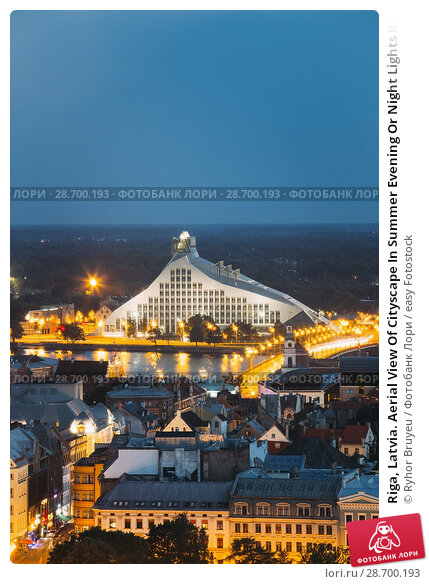 Купить «Riga, Latvia. Aerial View Of Cityscape In Summer Evening Or Night Lights Illumination. Top View Of Latvian National Library At Blue Hour.», фото № 28700193, снято 2 июля 2016 г. (c) easy Fotostock / Фотобанк Лори