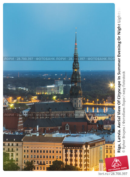 Купить «Riga, Latvia. Aerial View Of Cityscape In Summer Evening Or Night Lights Illumination. Top View Of St. Peter's Church. Blue Hour. Famous Landmark.», фото № 28700397, снято 2 июля 2016 г. (c) easy Fotostock / Фотобанк Лори