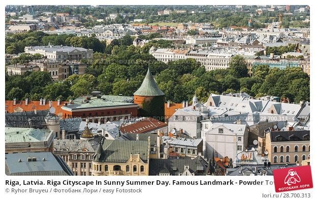Купить «Riga, Latvia. Riga Cityscape In Sunny Summer Day. Famous Landmark - Powder Tower.», фото № 28700313, снято 1 июля 2016 г. (c) easy Fotostock / Фотобанк Лори