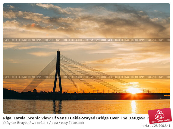 Купить «Riga, Latvia. Scenic View Of Vansu Cable-Stayed Bridge Over The Daugava River, Western Dvina In Bright Sunset Or Sunrise Time.», фото № 28700341, снято 1 июля 2016 г. (c) easy Fotostock / Фотобанк Лори