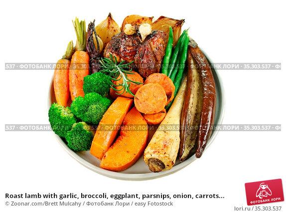 Roast lamb with garlic, broccoli, eggplant, parsnips, onion, carrots... Стоковое фото, фотограф Zoonar.com/Brett Mulcahy / easy Fotostock / Фотобанк Лори