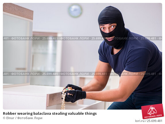 Robber wearing balaclava stealing valuable things, фото № 25699481, снято 12 декабря 2016 г. (c) Elnur / Фотобанк Лори